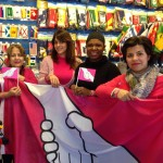 The Flag Shop Toronto holding up the Anti-Bullying flag for Pink Shirt Day on February 25th.