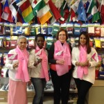 The Flag Shop Montreal shows off their pink scarves and paper flags.